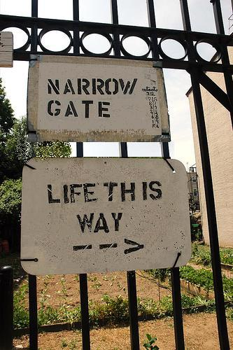 sign that says narrow gate life this way